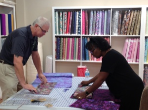 Allen and Rose, our BabyLock Representatives cutting fat quarters from all our new fabrics!